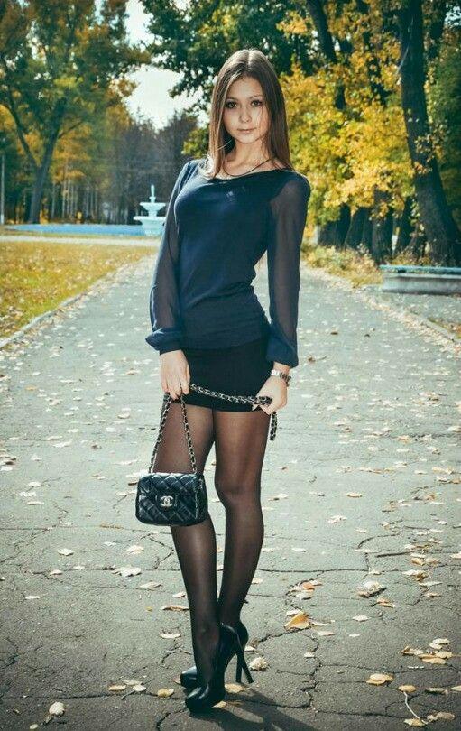 Hot Girl In Black Top And Mini Skirt