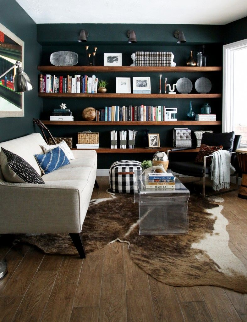 From my living room greenpoint works acapulco chair in leather meets -  This Study In The Home Of Bloggers Chris Loves Julia Masculine And Manly Decor Rugged Cowhide Rug Dark Green Paint Beige Couch Leather Club Chair