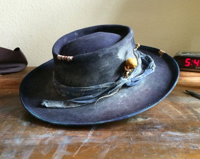 97501cfc6d7b8 Aged and distressed custom wide brim hat. With a baby snake in the band