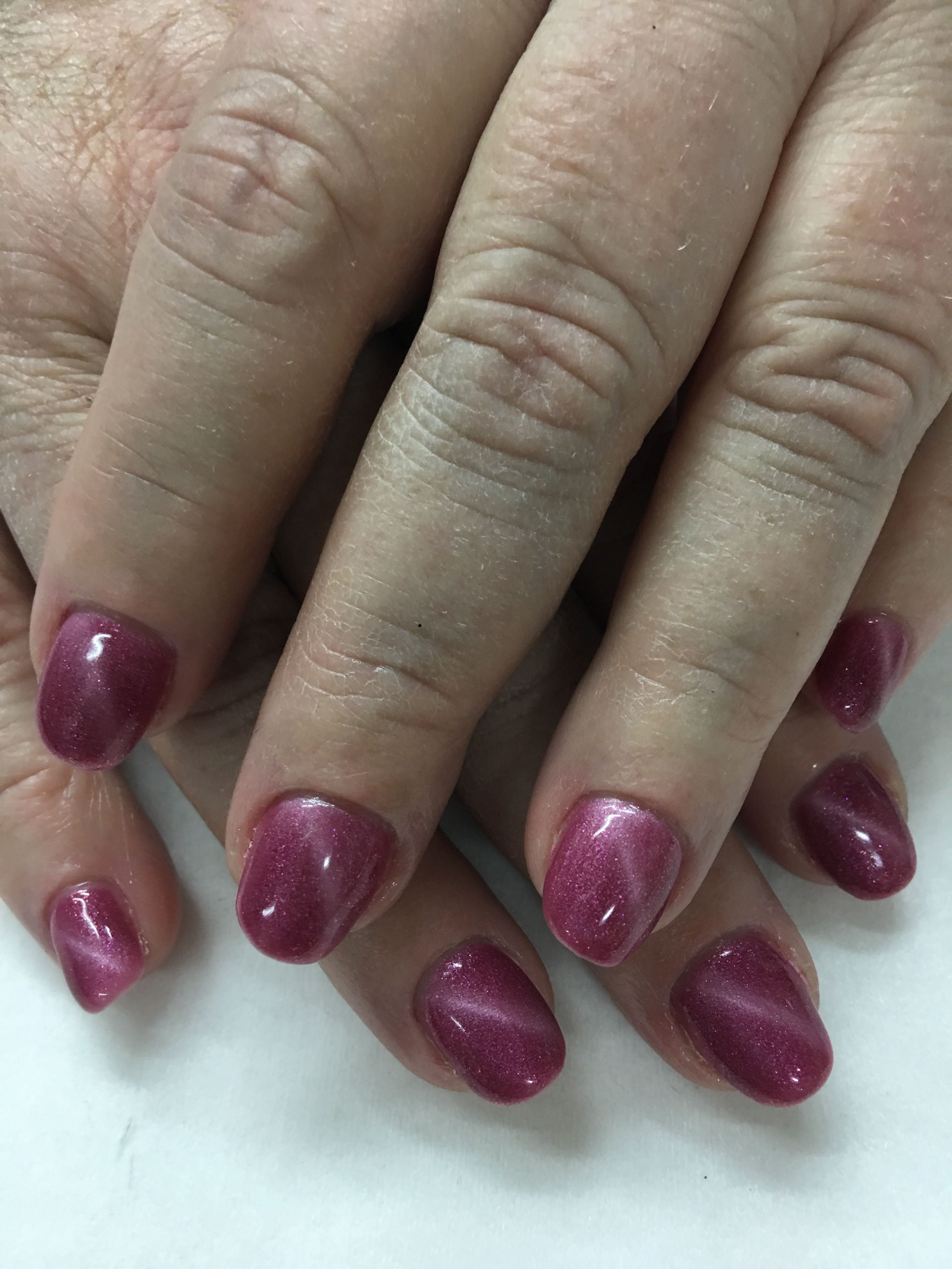 Magnetic Pink Cat Eye Gel Nails