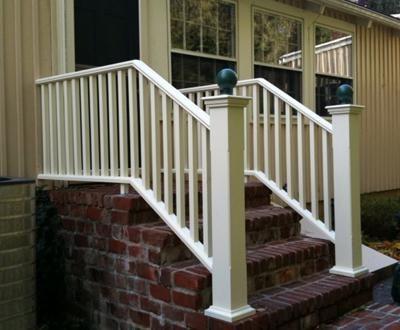 Step Railing   A Cream Colored Pendleton Stairway Railing With Contrasting  Dark Sphere Post Caps Sits Elegantly On Brick Steps.