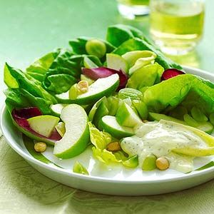 Granny Smith apples add a sweet crispness to this light and healthy salad with zesty lemon flavors. Grapes and Belgian endive bring special taste to this fresh side dish recipe.