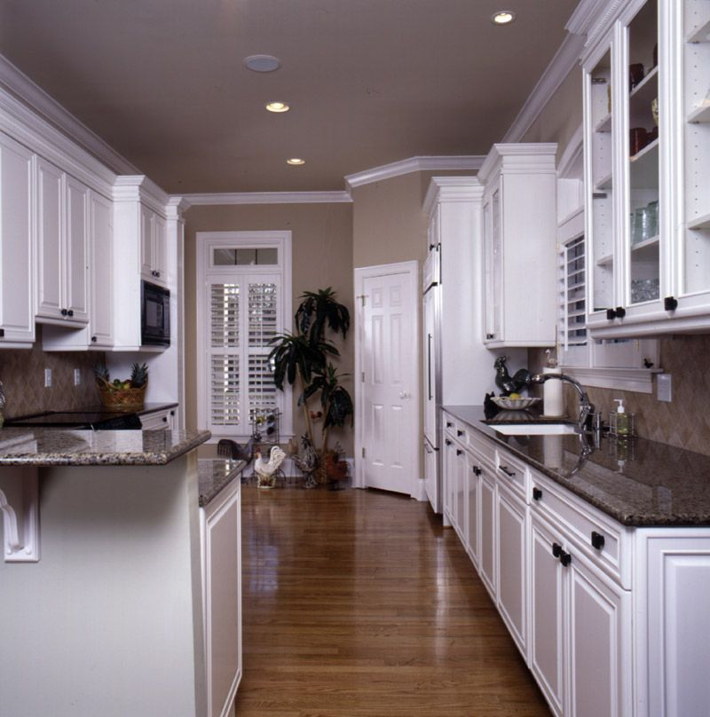 astounding white kitchen cabinets wood floors | Stark white cabinets, marble counter and wood floor in ...