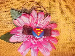 Superhero Boutonnieres... so appropriate seeing as how my boyfriend which I hope to be my future husband loves superman