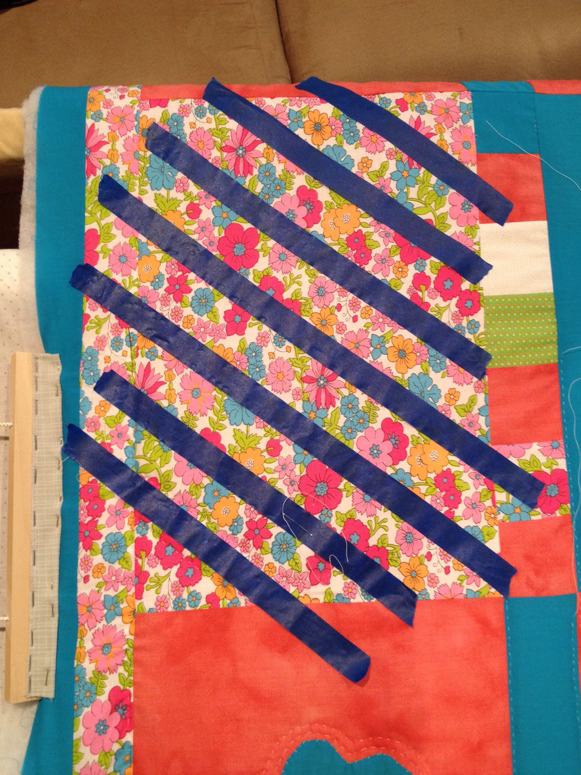 Use painters tape to mark lines to quilt instead of pencil marking. Easy to relocate to the next block. Real time saver :)