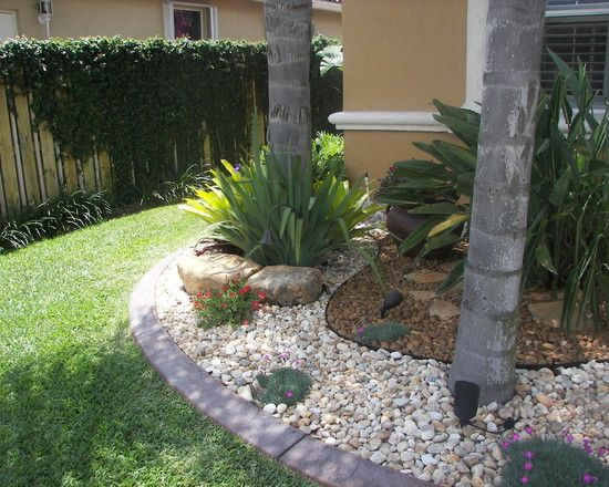 fascinating river rock landscaping pictures   tropical landscape palm tree garden with two tone
