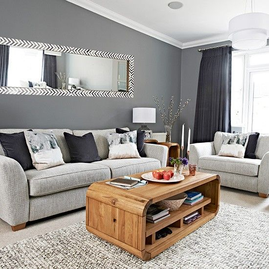 Chic grey living room with clean lines   Home Sweet Home     A dynamic mirror as wide as your sofa will add so much depth and reflected  light to a chic grey living room