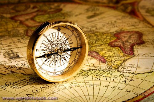 Stock Photo titled: An Antique Gold Compass Set Upon A Sixteenth Century Map Of The World, unlicensed use prohibited