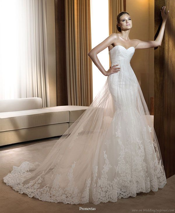 763a7270a1 Pronovias 2011 Bridal Gown Collection - Finisterre wedding dress with  double skirt of sheer lace hem tulle over mermaid skirt