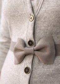 Bow tie belt with a long boy friend cardigan.
