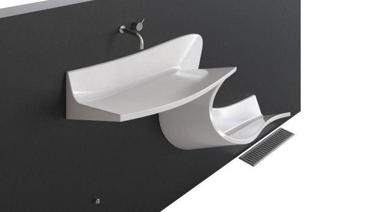 lavabo design innovant en forme de s et robinetterie encastrée
