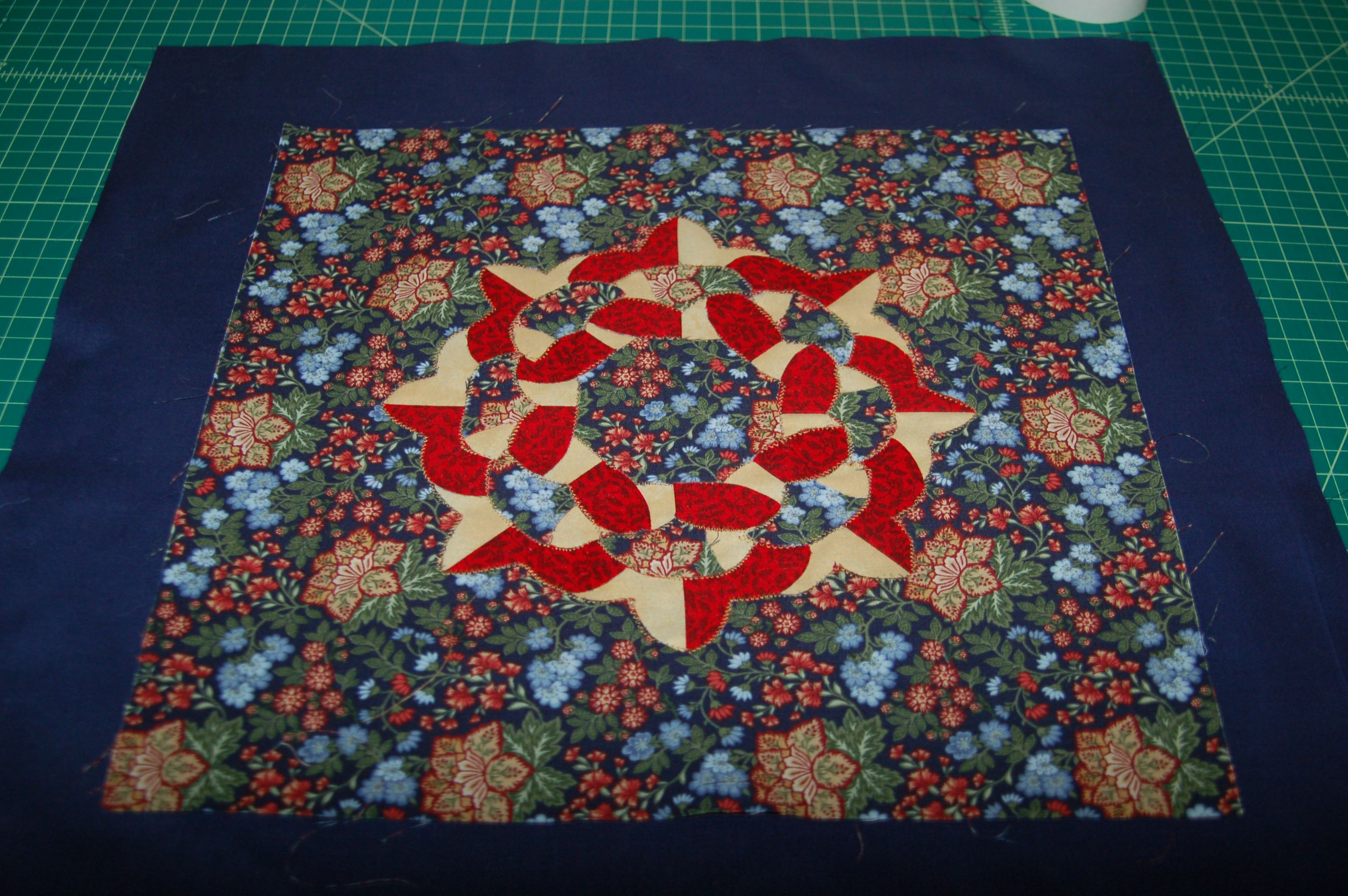 Cut and fold quilting.  I haven't decided whether to make a pillow or make 3 similar blocks for a wall hanging.