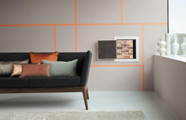 zona living dal design moderno ed essenziale con un divano grigio e ...