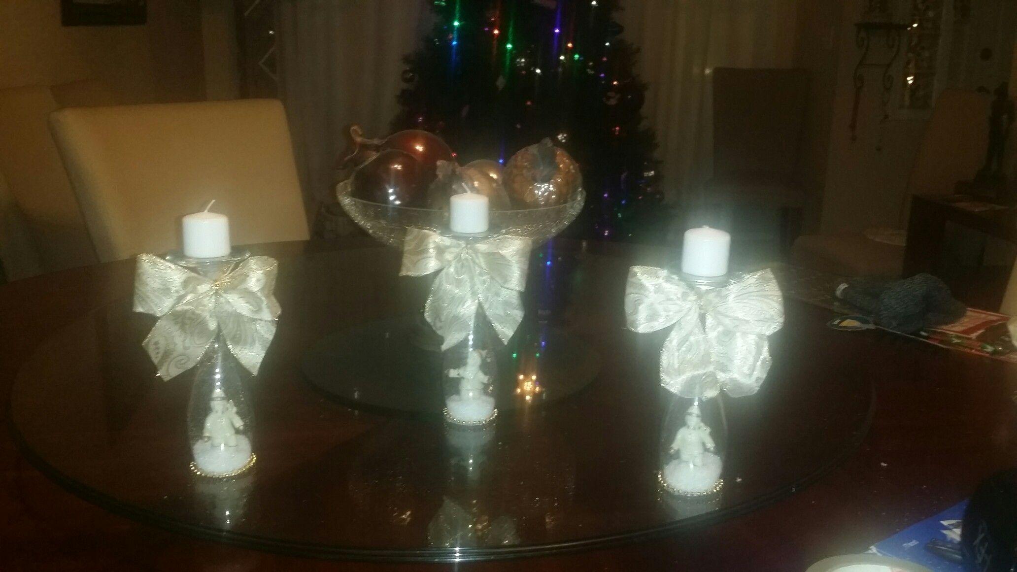 Wine glass with candle n figurine.
