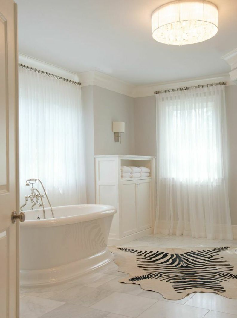 A #zebra #hyde #rug is unexpected in this #luxury #bathroom and ...