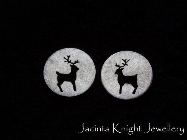 New earring design - reindeer studs. Sterling silver stud earrings with a reindeer design hand cut using a jeweler's saw.
