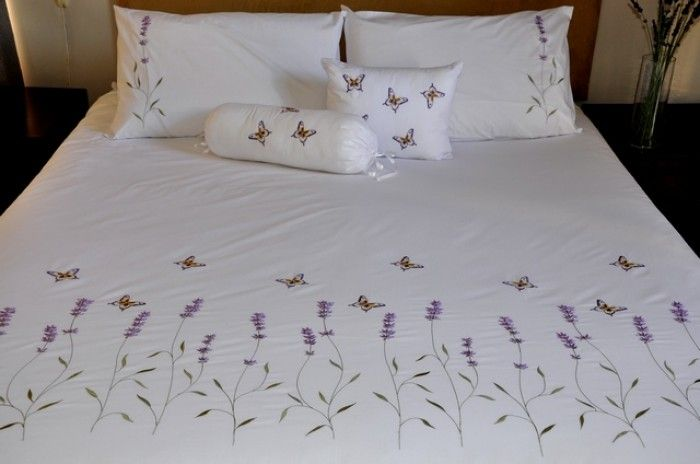 Lavender-The duvet cover has lavender flowers and butterflies embroidered across the bottom of the bed, with 1 lavender flower on the pillow case side.