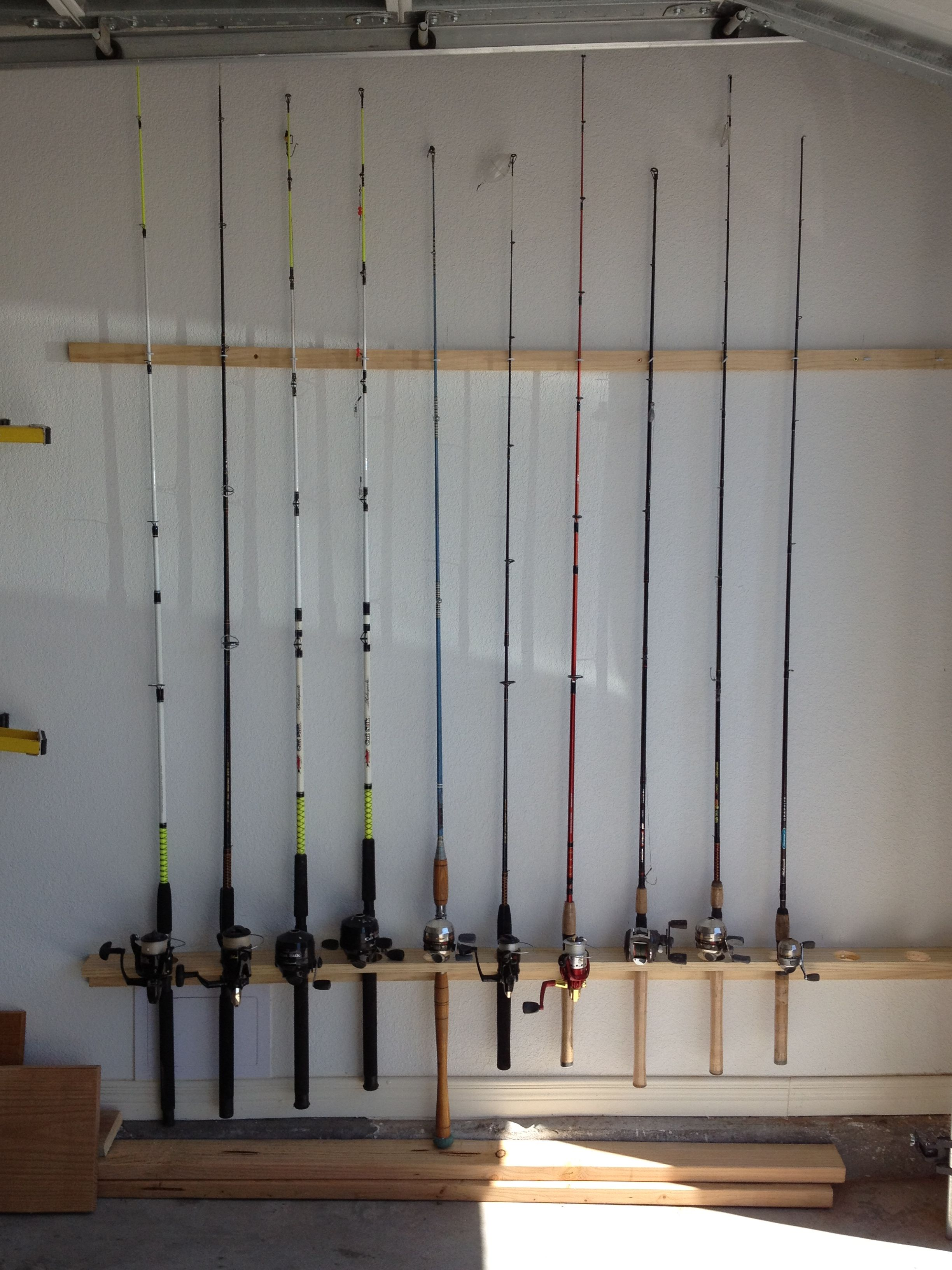 Diy fishing rod holder for the garage home pinterest for Homemade fishing rod holders