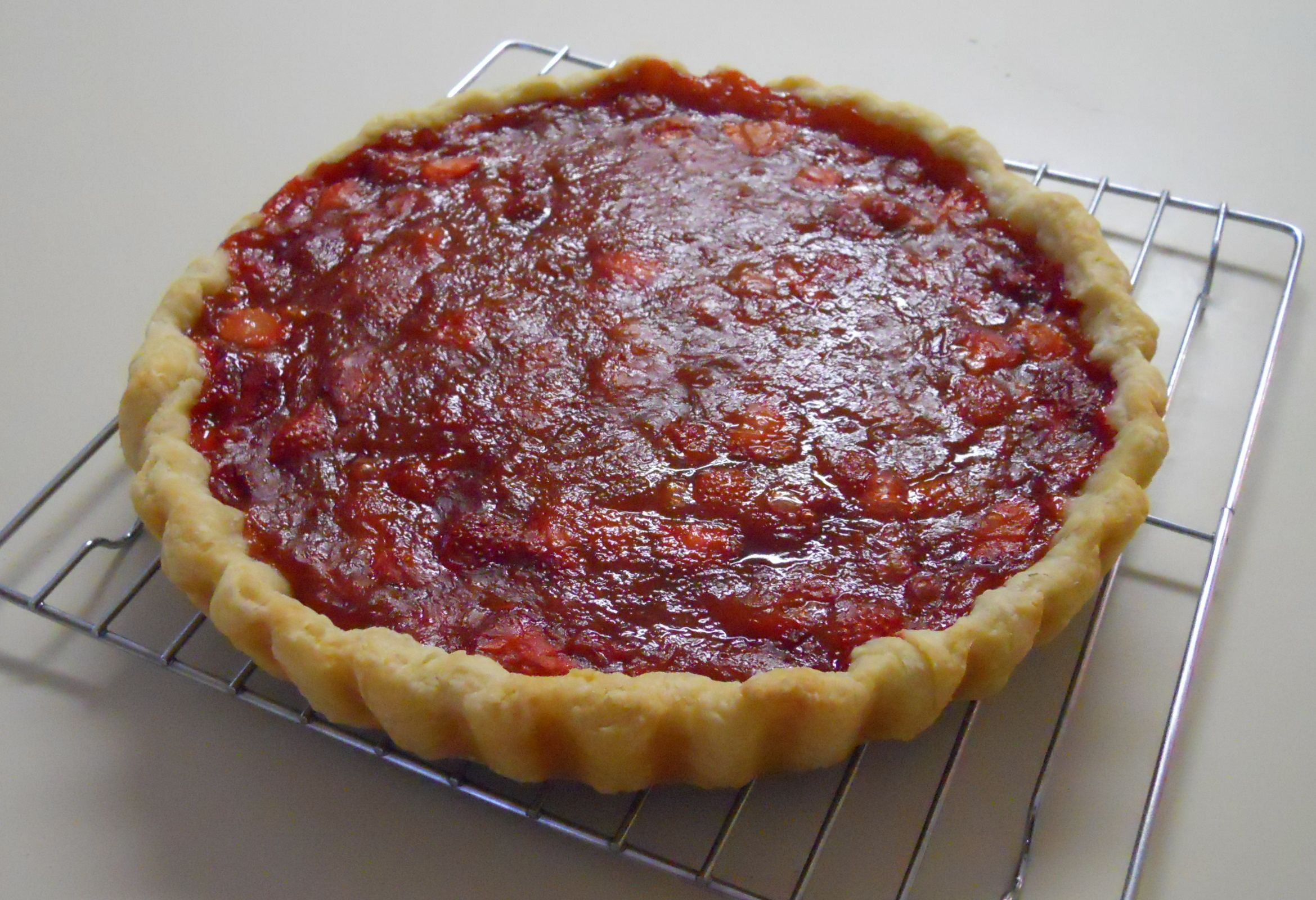 Homegrown strawberries and rhubarb turned into a delicious tart.