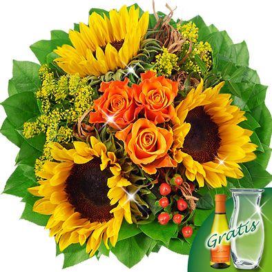 Blumenstrauß Vincent mit Vase & Secco  Sonnenblumen und Rosen in absoluter Farbharmonie.  Ihr Blumengruß besteht aus 3 orangen Rosen, 3 Sonnenblumen, 3 Pistochia, 10 Salal, 1 Solidago, 1 Hypericum und 1 Dill. Der Durchmesser beträgt ca. 30 cm. Dazu erhalten Sie einen Beutel Blumennahrung und eine Pflegeanleitung.  Gratis dazu: Glasvase und eine Flasche Secco 0,2l