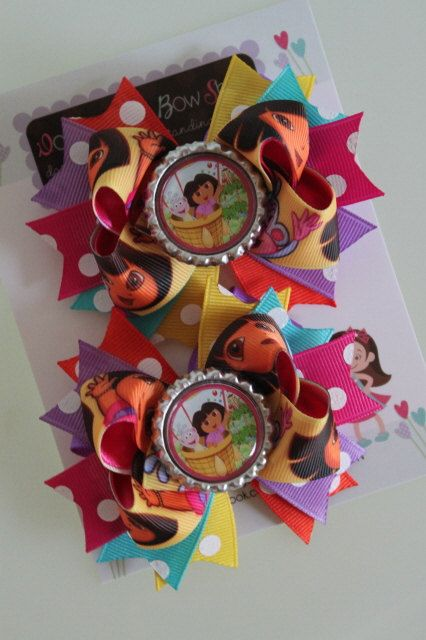 Dora pigtail bows -- Dora and Boots bottlecap bow -- lots ...