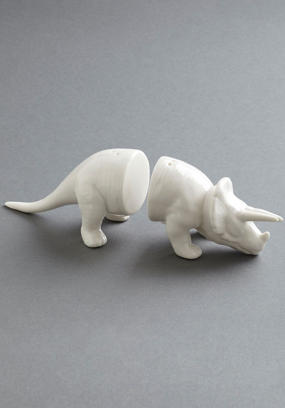 Spice-eratops Shaker Set. Give your modern kitchen a dash of prehistoric pizzazz with these triceratops salt and pepper shakers from IMM Living. #white #modcloth