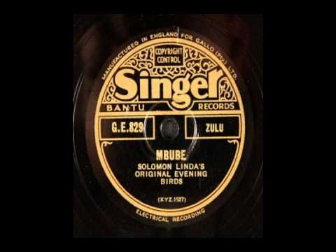 "Solomon Linda & The Evening Birds, Mbube (1939) - YouTube.  [This is the original recording in Zulu or ""Kwa-Zulu"" language of the tune which would later have English lyrics written to go with it to become ""The Lion Sleeps Tonight"" which was recorded by The Tokens.  Keep in mind, numerous other people recorded versions of this song.  Notice the chants and yodels that carry over in some form in each version. See ""Mbube"",  ""Wimoweh"", and ""The Lion Sleeps Tonight"".]"