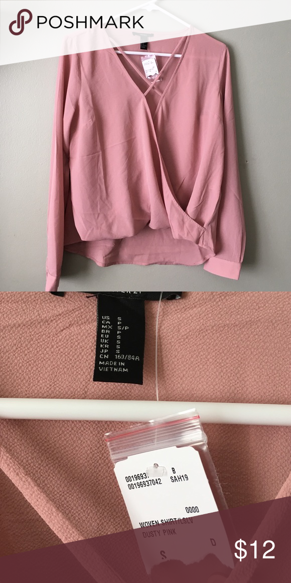 Blush V-Neck Blouse Super cute blush colored top with dramatic neckline and crisscross detail ❤️ beautiful and perfect for any occasion. Brand new with tags, received as a gift. 👏 Forever 21 Tops