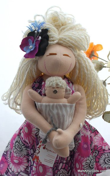 This doll is a one of a kind- original MamAmor doll. She gives birth and breastfeeds her newborn baby. She is a VBAC mama, but she can also demonstrate a cesare