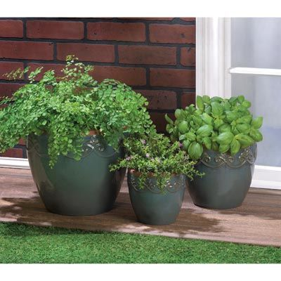 Misty sea blue is a timeless hue that brings these ceramic planters to life! Three coordinating pots create a look of effortless elegance as you watch your garden grow. Drain hole at the bottom of each pot.