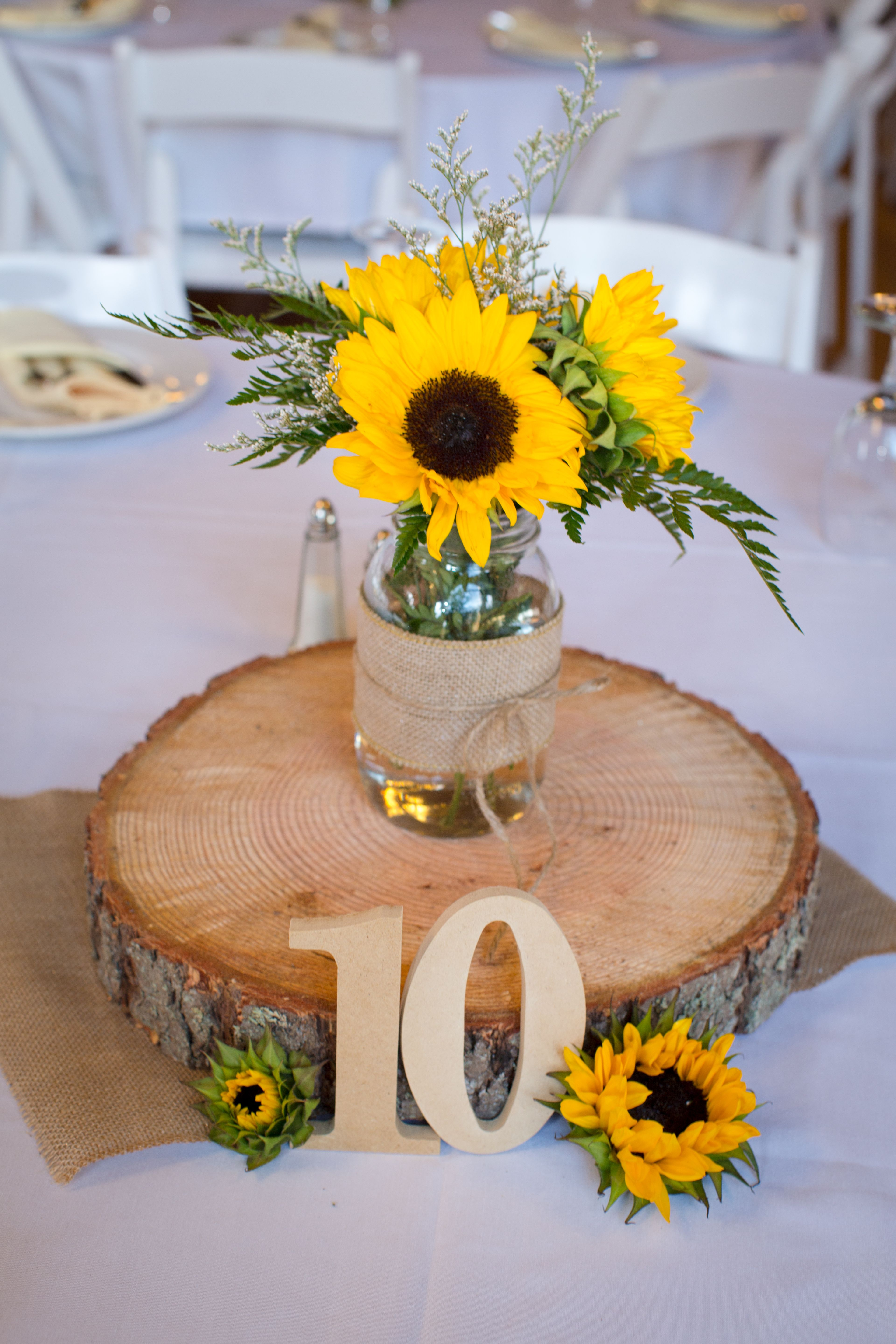 Wooden slab centerpiece and table number wedding decor