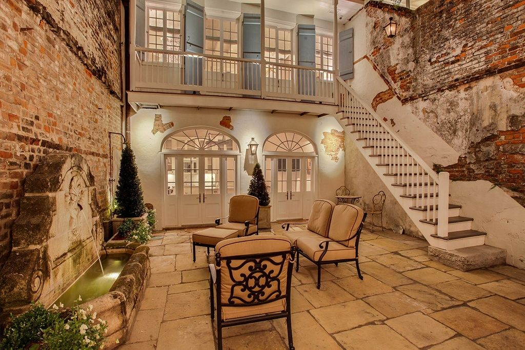 9 French Colonials That Channel Classic New Orleans Style Courtyard Design French Style Homes Colonial House