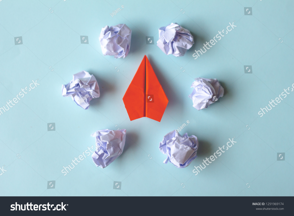 Red Paper Airplane Crumpled Paper Balls Stock Photo Edit Now 1291969174 Paper Balls Red Paper Crumpled Paper