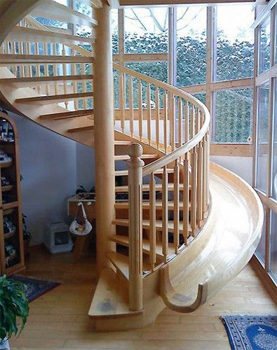 A staircase with a slide, when you need to get down quickly and when you just wanna have a little childlike fun.