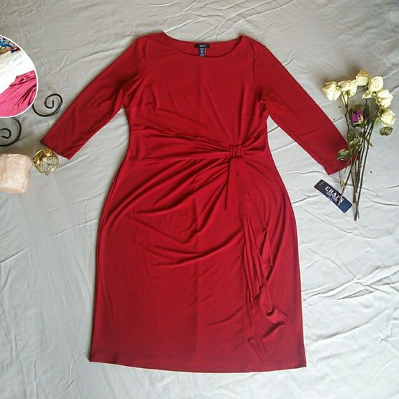 "NWT CHAPS RALPH LAUREN XL RED 3/4 SLEEVE DRESS BRAND NEW WITH TAGS 95% POLYESTER 5% ELASTANE? MACHINE WASHABLE? SLEEVES MEASURE APPROX 20""? FROM SEAM TO SEAM ACROSS THE BUST MEASURES APPROX 21"" LYING FLAT? FROM SHOULDER TO HEM MEASURES APPROX 39""? FROM SEAM TO SEAM ACROSS THE SMALLEST PART OF THE WAIST MEASURES APPROX 18"" STORED IN NON-SMOKING PET FREE HOME Chaps Dresses"