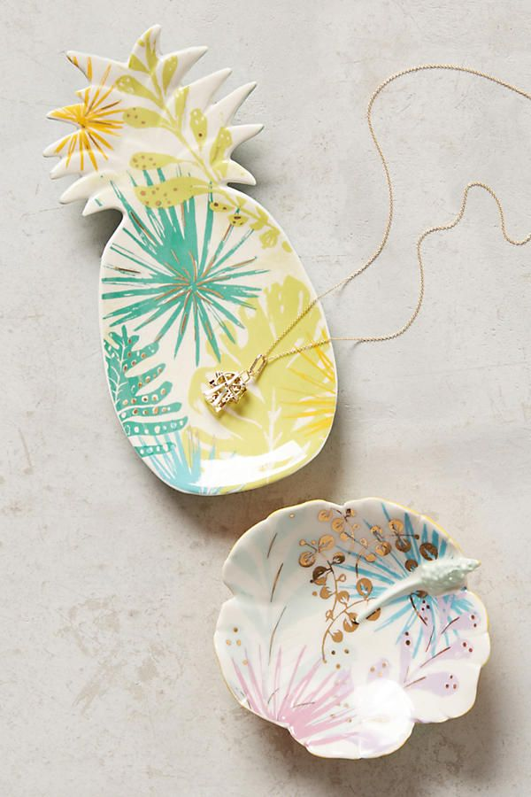 Pineapple and Island-Grown Trinket Dishes. Whether placed on your desk to hold pins and clips or set on your dresser as a home for post earrings and rings, these sweetly designed trinket dishes are as delightful as they are is functional. Perfect for your glistening jewels.