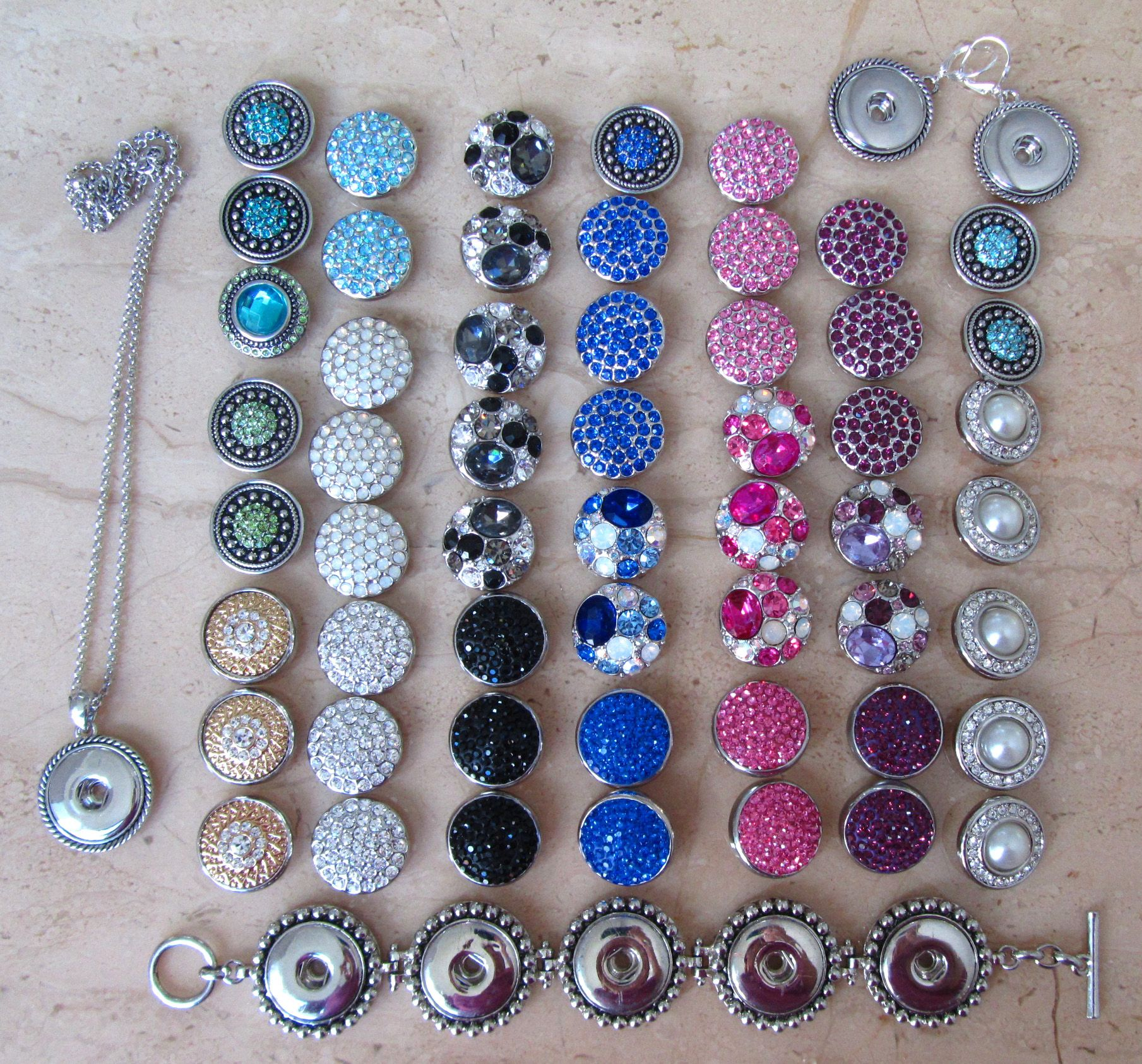 These are the beads I have so far and interchange to make the bracelets, necklaces and earrings shown on this board.