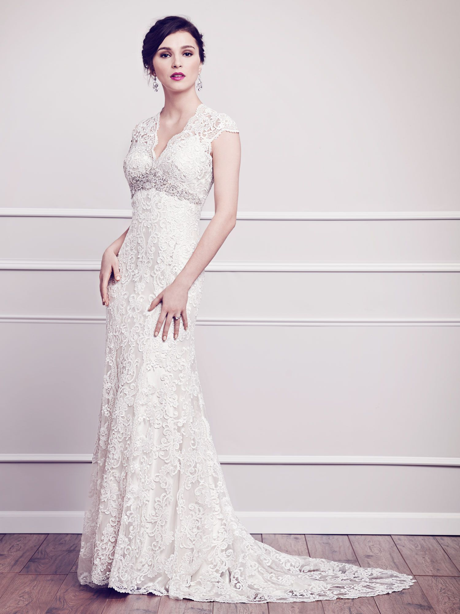 Classic vneckline gown wrapped with floral arrangements made of