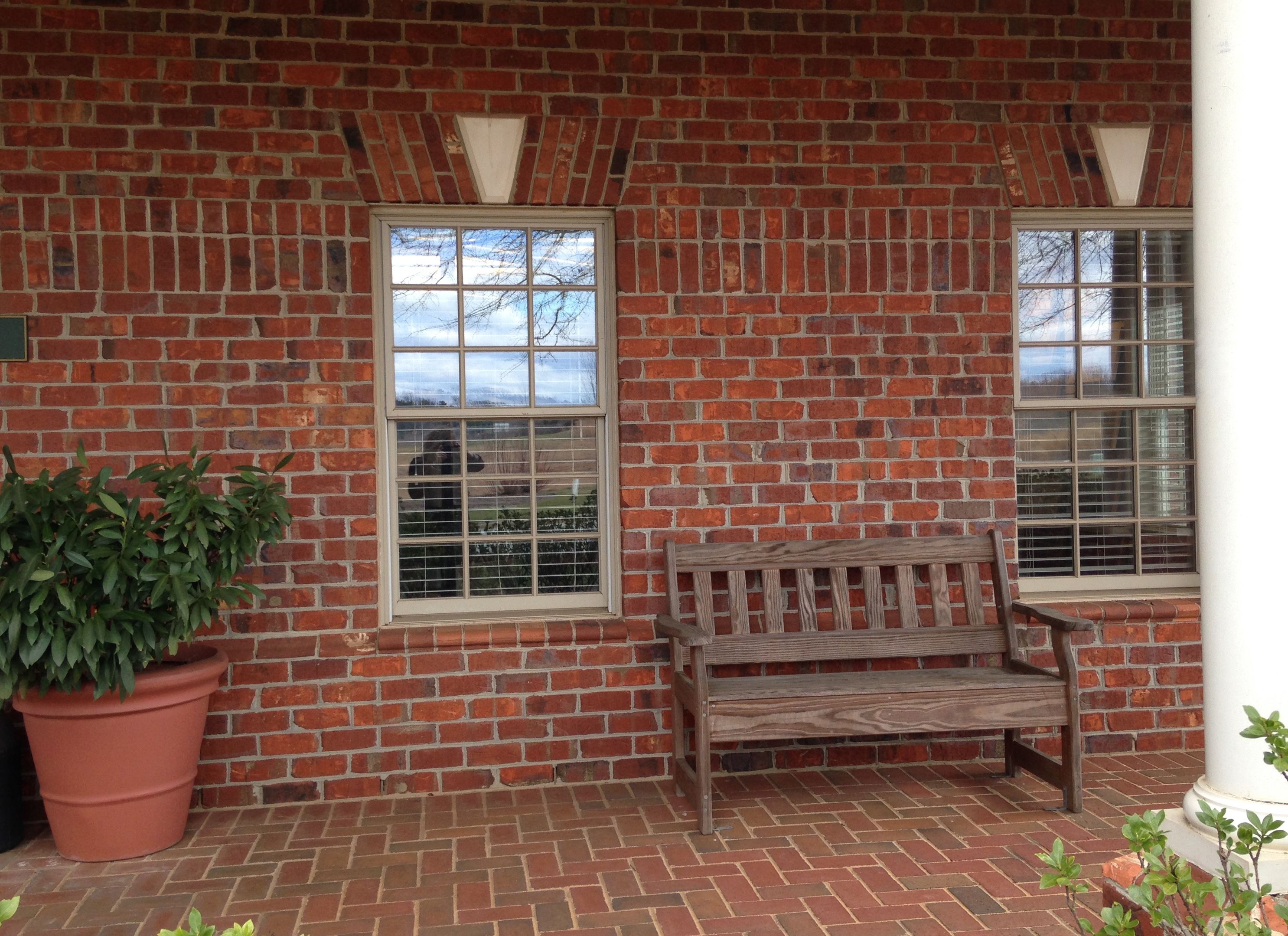 A red brick exterior with contrasting but monochromatic ... on Red Paver Patio Ideas id=61009