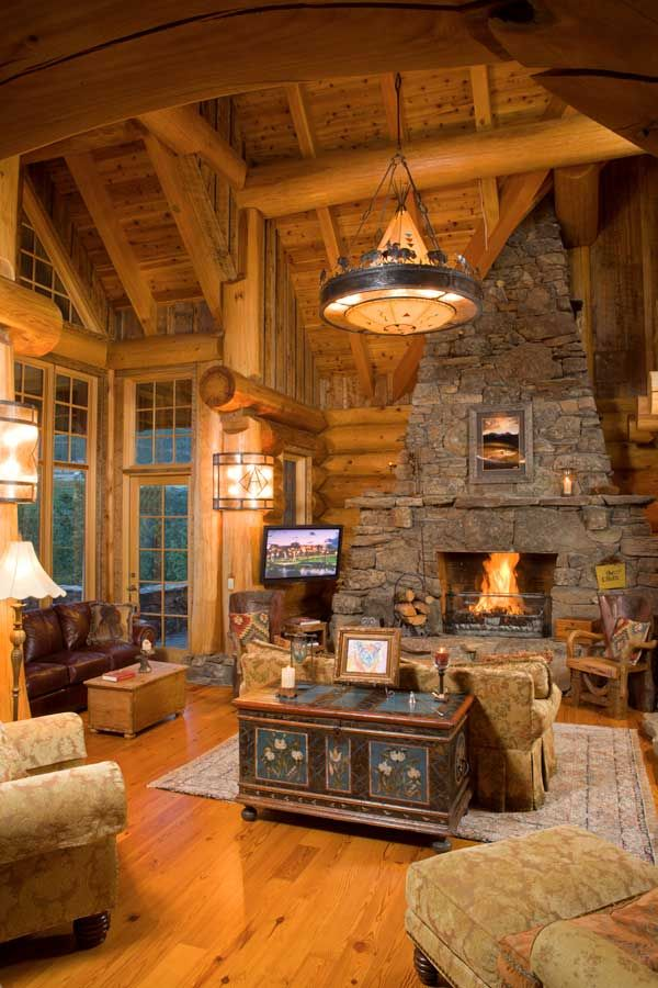 Love this great room fantastic lighting r u s t i c for Log cabin fireplaces pictures