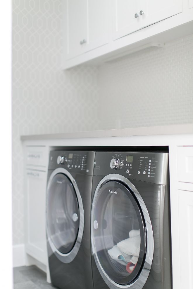 White laundry room features a side by