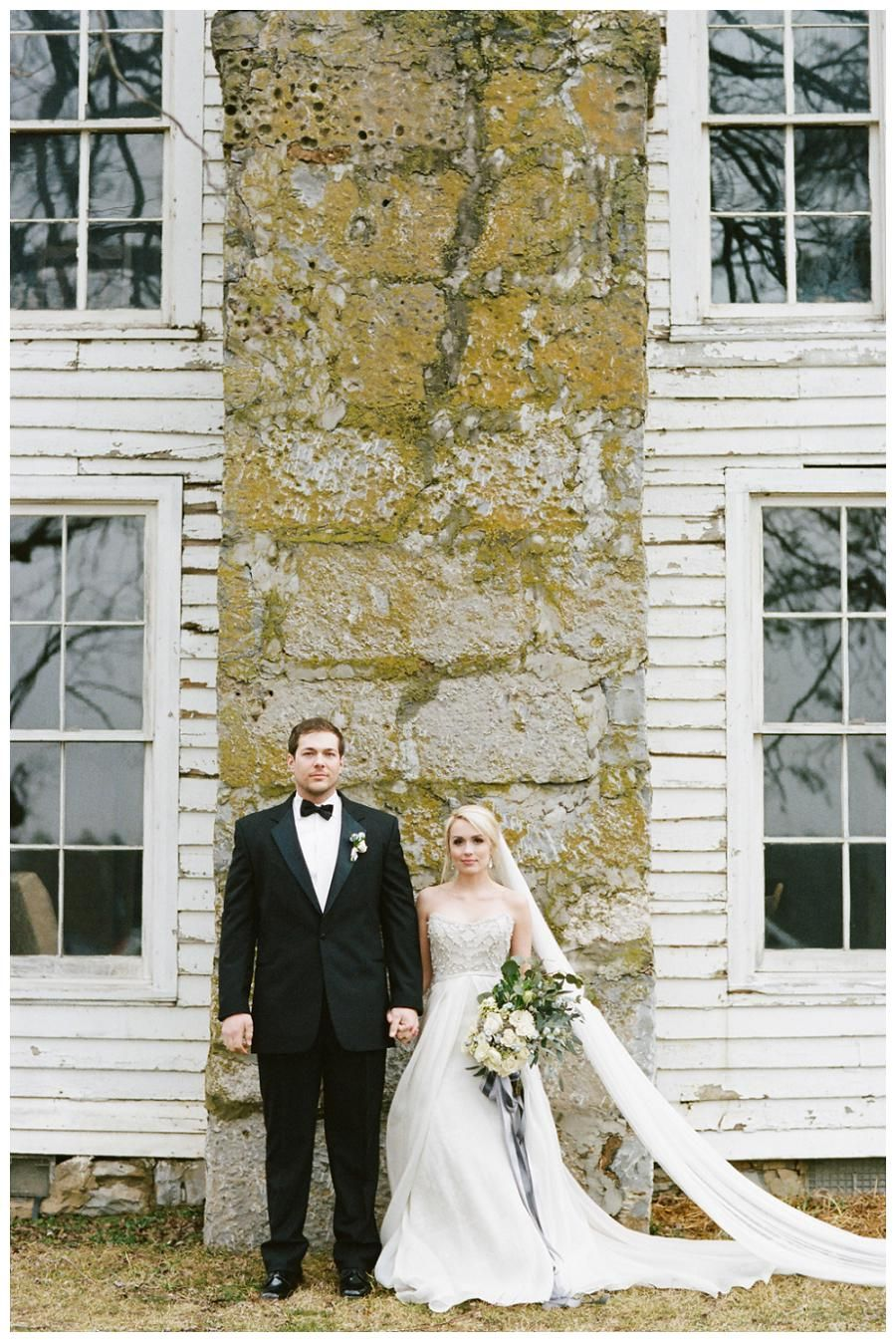 Beautiful bride and groom at The Hardy Chambers Farmhouse at Fly Creek Farm in Pulaski, TN. Image by White Rabbit Studios.