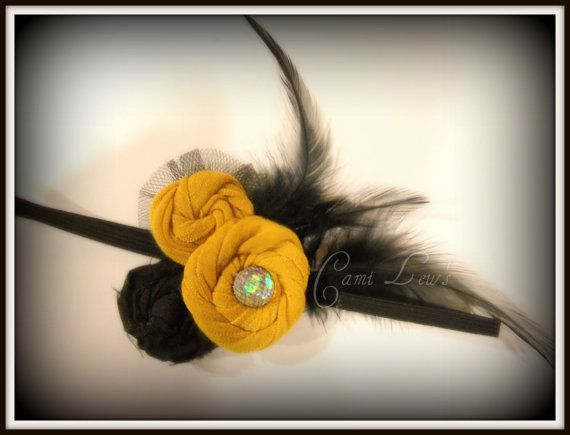 yellow and black feather fabric flower head band