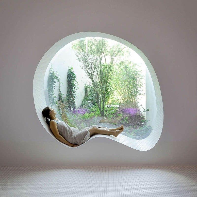 Window seat overlooks a small garden