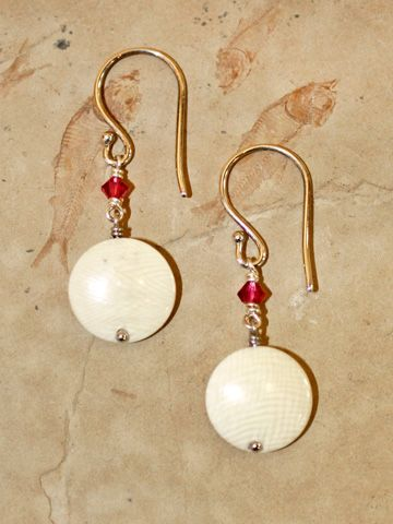"""Ancient mammoth ivory domed circle earrings, set with sterling silver french hooks and accented with faceted Swarovski crystals. Size: 1 3/8"""" Including Hook Price: $65.00  -- on ScrimshawGallery.com #jewelry #earring #ivory"""