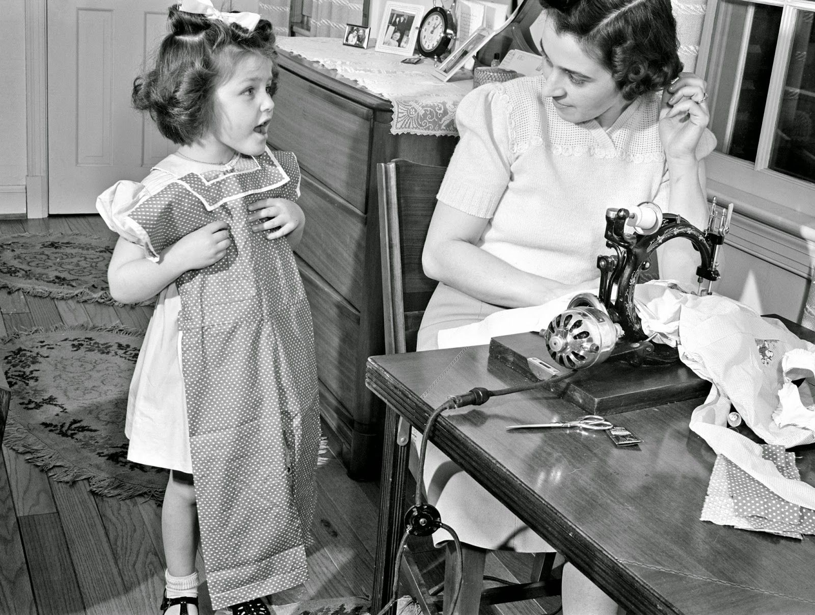 Attractive playsuits for daughter can be made from that old housedress, the one with the splitting seams, and Junior's first long pants (no cuffs) can emerge from father's old overcoat. February 1942