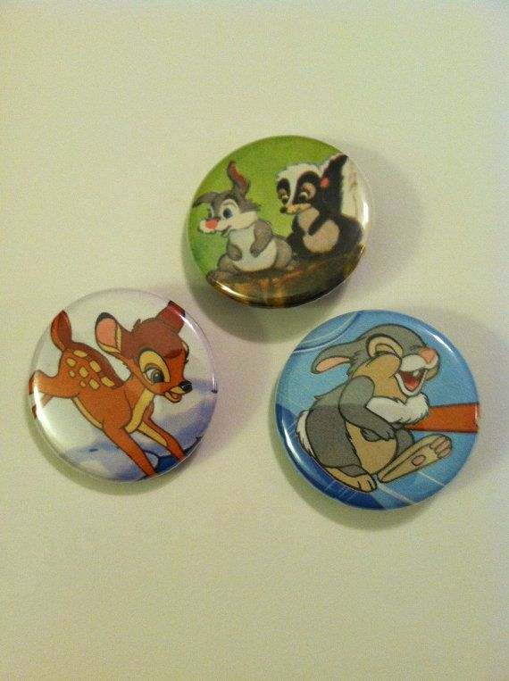 Three pin-back buttons/Badges featuring Bambi, Thumper, and Flower from Disneys Bambi. The buttons are 1 1/4 in diameter which is the standard button