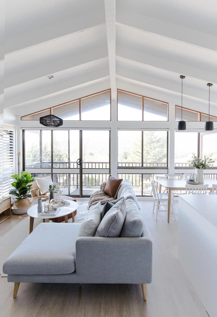 Living Room With White Pitched Ceiling And Exposed Beams With Pendant Lights Pale Blue Couch Wi Trendy Living Rooms Luxury Living Room Living Room Inspiration #pale #blue #living #room