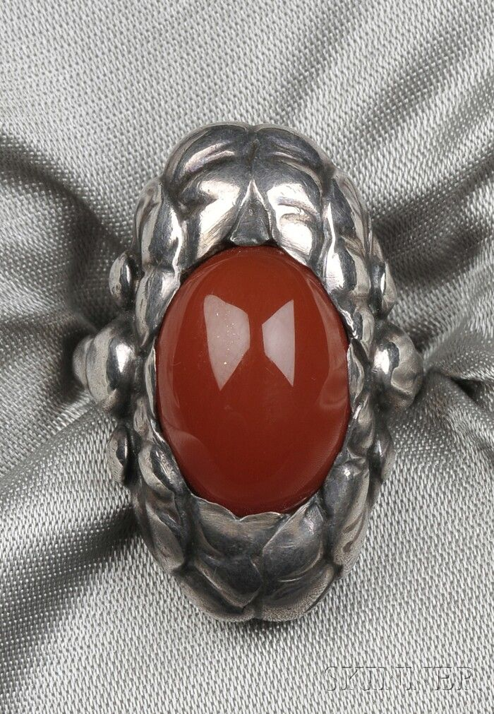 Sterling Silver and Carnelian Ring, Georg Jensen, designed as an oval cabochon within a foliate surround, size 5 1/4, no. 11, signed Georg Jensen, Denmark.