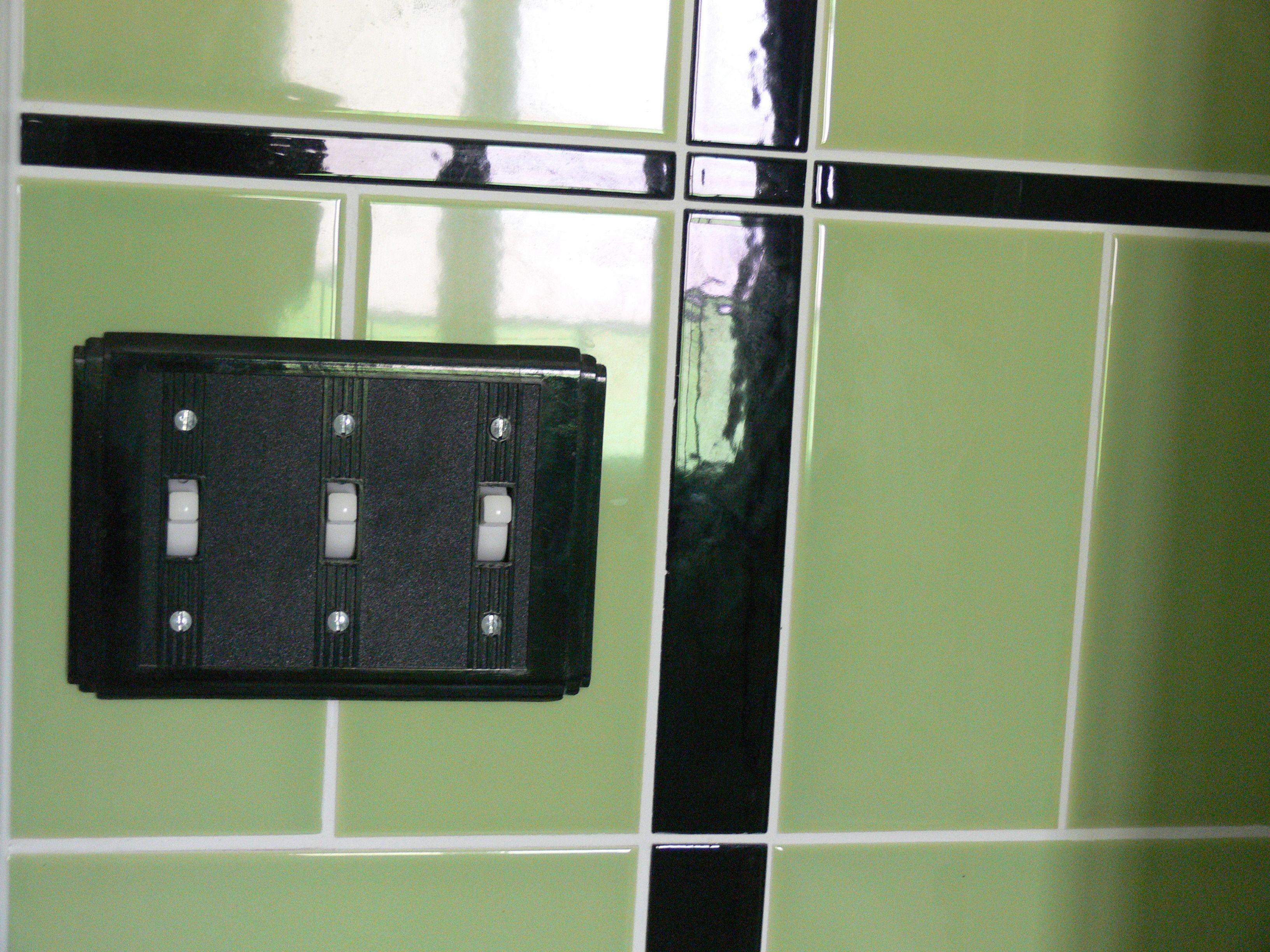 Details of our art deco bathroom. Re-manufactured bakelite light ...